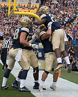 Pitt running back AJ Davis (21) celebrates with teammates after his first touchdown. The Pitt Panthers defeated the Youngstown State Penguins 28-21 in overtime at Heinz Field, Pittsburgh, Pennsylvania on September 02, 2017.