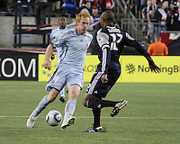 Colorado Rapids midfielder Jeff Larentowicz (4) and New England Revolution defender Cory Gibbs (12) clash.  The Colorado Rapids defeated the New England Revolution, 2-1, at Gillette Stadium on April 24.2010