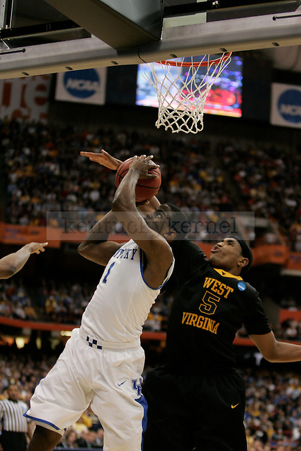 UK's Darius Miller battles underneath the net against West Virginia's Kevin jones at the Carrier Dome on Saturday, March 27, 2010. Photo by Scott Hannigan | Staff