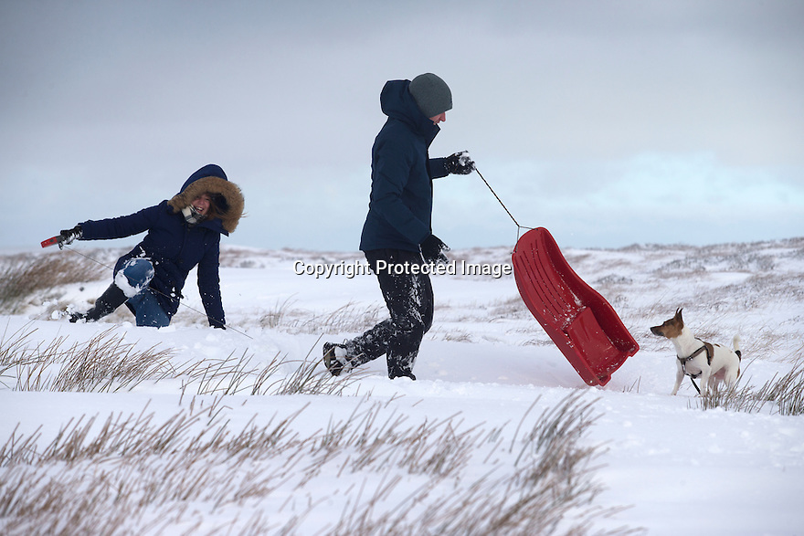 13/01/17<br />  <br /> Amy Field and Mark Beresford sledge in deep snow with their dog Ruby near the Cat and Fiddle between Macclesfield and Buxton in the Peak District.<br /> <br /> <br /> All Rights Reserved F Stop Press Ltd. (0)1773 550665   www.fstoppress.com