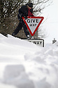 25/03/13 ..Anna Ryder, clambers over a snowdrift that is as high as a road sign as winter continues not to give way to spring, in Sparrowpit, Derbyshire...All Rights Reserved - F Stop Press.  www.fstoppress.com. Tel: +44 (0)1335 300098.
