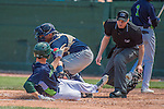 2 August 2016: Umpire Louie Krupa watches a sliding Luke Persico get tagged out at home by catcher Mario Sanjur during a game between the Vermont Lake Monsters and the Connecticut Tigers at Centennial Field in Burlington, Vermont. The Tigers defeated the Lake Monsters 7-1 in NY Penn League play.  Mandatory Credit: Ed Wolfstein Photo *** RAW (NEF) Image File Available ***