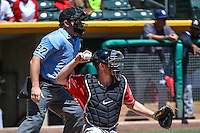 Rocky Gale (17) of the El Paso Chihuahuas on defense against the Salt Lake Bees with home plate umpire Bryan Fields making the calls in Pacific Coast League action at Smith's Ballpark on July 26, 2015 in Salt Lake City, Utah., El Paso defeated Salt Lake 6-3 in 10 innings. (Stephen Smith/Four Seam Images)