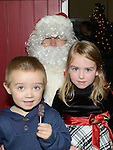 Sarah Connolly and Thomas Levins pictured with Santa at the christmas craft fair in Clogherhead community hall. Photo:Colin Bell/pressphotos.ie