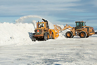 A Caterpillar snowblower blows snow from a parking lot in Levis January 4, 2010.