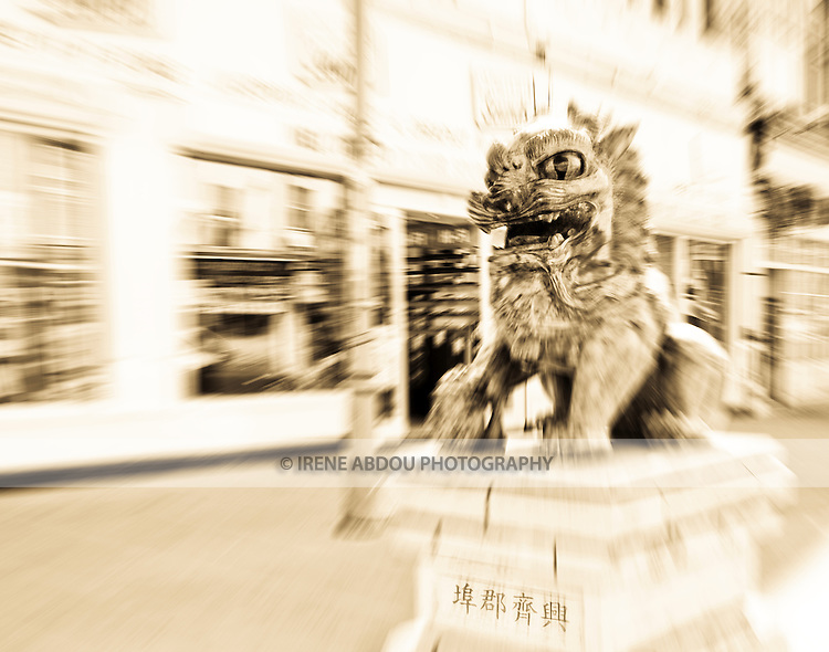 A pair of lions stand guard at the entrance of Liverpool's Chinatown.  Liverpool was named Europe's official Capital of Culture for 2008.