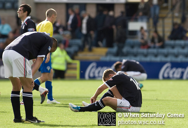 Dundee 0 Greenock Morton 1, 27/08/2011. Dens Park, Scottish League First Division. Dundee players slump to the ground at the final whistle of a Scottish League First Division match at Dens Park stadium against visitors Greenock Morton. The visitors won by one goal to nil watched by a crowd of 4,096. Dundee  stadium was situated on the same street as their city rival Dundee United, whose Tannadice Park ground was situated a few hundred yards away.