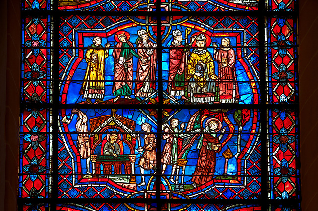 Medieval stained glass Window of the Gothic Cathedral of Chartres, France - dedicated to the Life of St Remigius (Remy). Bottom left - Brigands attack Remigius in his hermitage, bottom right - Remigius escapes, top left - Remigius is chosen to be Archbishop of Reims, top right- Installation of Remigious as Archbishop. A UNESCO World Heritage Site.