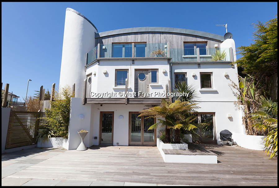 BNPS.co.uk (01202 558833)<br /> Pic: Jackson-Stops/BNPS<br /> <br /> ****Must use full byline****<br /> <br /> The property's sprawling paved garden.<br /> <br /> A stunning cliff-top house has grown into a 1.25 million pounds property after it was built on a disused allotment.<br /> <br /> Jamie and Zoe McLintock forked out £80,000 for the overgrown plot of land eleven years ago because it was atop a cliff along Devon's craggy coastline.<br /> <br /> The enterprising couple spent a further £600,000 and three years of their time building the beautiful five-bedroom pad.<br /> <br /> But they are now set to double their money after the incredible property went on the market for a whopping £1.25 million with estate agents Jackson-Stops.<br /> <br /> The white-washed three-storey house is perched on top of 100ft cliffs overlooking Tunnels Beaches in Ilfracombe, a stretch of private Victorian beach owned by the couple since 2001.