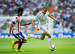 The Real Madrid Player Pepe and the Atletico de Madrid player Raul Garcia in a league football match in santiago Bernabeu stadium. 2014/09/13. Madrid. Spain. Samuel de Roman / Photocall3000