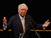 Washington, DC - (FILE) -- Legendary CBS newsman Walter Cronkite speaks at a ceremony at the National Air and Space Museum in Washington celebrating the 35th anniversary of Apollo 11 in 2004..Mandatory Credit: Bill Ingalls - NASA via CNP.