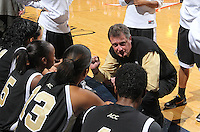 Feb. 3, 2011; Charlottesville, VA, USA; Wake Forest Demon Deacons head coach Mike Peterson talks with his team during the game against the Virginia Cavaliers at the John Paul Jones Arena.  Mandatory Credit: Andrew Shurtleff