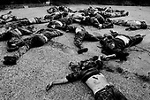 Sukhumi, Abkhazia<br /> September 28, 1993<br /> <br /> Dead Georgian soldiers are found collected in a small parking lot on the out skirts of the city. They appear to have been executed. Only Abkhazian separatists roam the streets after they captured the city the day before.