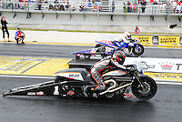 Mar. 10, 2012; Gainesville, FL, USA; NHRA pro stock motorcycle rider Eddie Krawiec (near lane) races alongside Hector Arana Jr during qualifying for the Gatornationals at Auto Plus Raceway at Gainesville. Mandatory Credit: Mark J. Rebilas-
