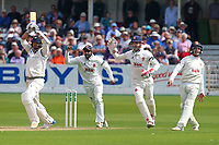 Essex players Varun Chopra and James Foster celebrate the wicket of  Jack Brooks from the bowling of Simon Harmer during Yorkshire CCC vs Essex CCC, Specsavers County Championship Division 1 Cricket at Scarborough CC, North Marine Road on 7th August 2017