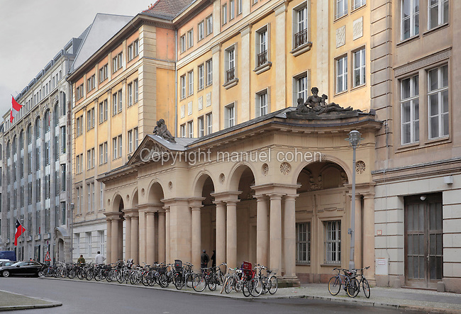 An 18th century colonnaded portico called Mohrenkollonaden, originally a barracks for military musicians, some of whom were Moors, on Mohrenstrasse, Mitte, Berlin, Germany. This road was heavily bombed in the Second World War, but most of the buildings have been renovated. Picture by Manuel Cohen