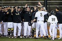 Johnny Aiello (2) of the Wake Forest Demon Deacons is greeted by his teammates after hitting a solo home run against the Georgetown Hoyas at David F. Couch Ballpark on February 19, 2016 in Winston-Salem, North Carolina.  The Demon Deacons defeated the Hoyas 3-1.  (Brian Westerholt/Four Seam Images)