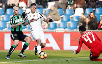 Calcio, Serie A: Sassuolo vs Juventus. Reggio Emilia, Mapei Stadium, 29 gennaio 2017. <br /> Juventus&rsquo; Paulo Dybala, center, is challenged by Sassuolo's Paolo Cannavaro, left, and goalkeeper Andrea Consigli during the Italian Serie A football match between Sassuolo and Juventus at Reggio Emilia's Mapei stadium, 29 January 2017.<br /> UPDATE IMAGES PRESS/Isabella Bonotto