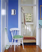 The bathoom is painted in fresh delphinium blue with woodwork picked out in contrasting brilliant white