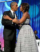 United States President Barack Obama embraces first lady Michelle Obama as they arrive on stage for the Congressional Black Caucus Foundation Annual Phoenix Awards dinner, September 21, 2013, Washington, DC. The CBC's annual conference brings together activists, politicians and business leaders to discuss public policy impacting black communities in America and abroad.   <br /> Credit: Mike Theiler / Pool via CNP
