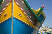 Colourfully painted boats in Marsaxlokk, Malta