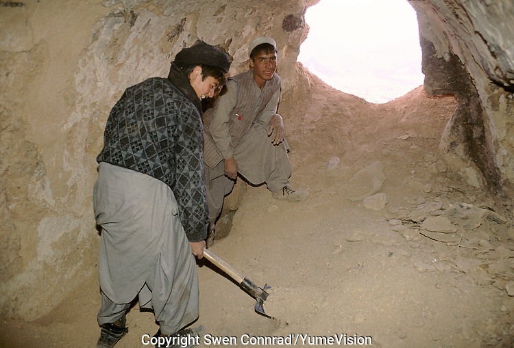 Two young adolescentâs digging in a Buddhist temple on the cliff next to the 54 meters Bamiyan Buddha, looking for artefact, fresco, or anything how can be sold to survive under the occupation of the region by the Taleban.