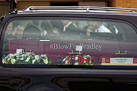"Pictured: The coffin in the hearse arrives at Aberavon Beach Hotel in Port Talbot, Wales, UK. Monday 08 October 218<br /> Re: A grieving father will mourners on horseback at the funeral of his ""wonderful"" son who killed himself after being bullied at school.<br /> Talented young horse rider Bradley John, 14, was found hanged in the school toilets by his younger sister Danielle.<br /> Their father, farmer Byron John, 53, asked the local riding community to wear their smart hunting gear at Bradley's funeral.<br /> Police are investigating Bradley's death at the 500-pupils St John Lloyd Roman Catholic school in Llanelli, South Wales.<br /> Bradley's family claim he had been bullied for two years after being diagnosed with Attention Deficit Hyperactivity Disorder.<br /> He went missing during lessons and was found in the toilet cubicle by his sister Danielle, 12."