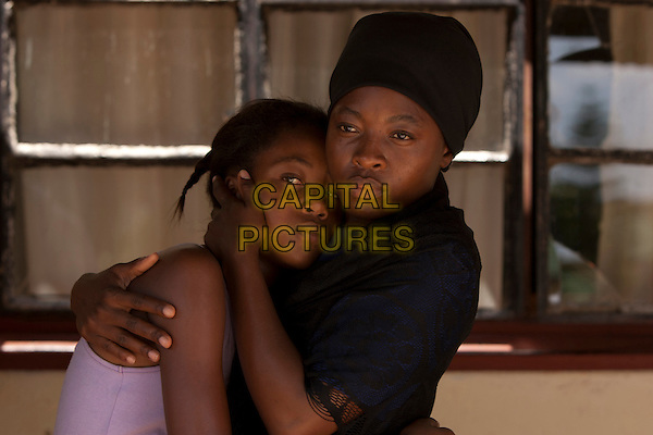KHOMOTSO MANYAKA & LERATO MVELASE.in Life, Above All .*Filmstill - Editorial Use Only*.CAP/FB.Supplied by Capital Pictures.