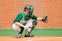 Charlotte 49ers catcher Brett Lang (6) between innings of the game against the Virginia Commonwealth Rams at Robert and Mariam Hayes Stadium on March 30, 2013 in Charlotte, North Carolina.  The 49ers defeated the Rams 9-8 in game one of a double-header.  (Brian Westerholt/Four Seam Images)