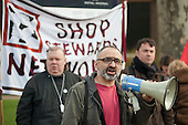 Onay Kasab, Branch Chair of Greenwich Unite.  March against proposed cuts in spending by Greenwich Council, Woolwich, London.