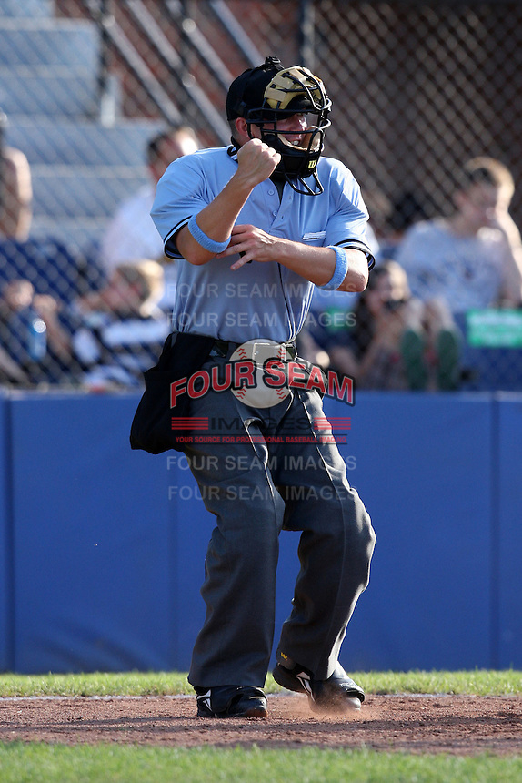 Home plate umpire Chris Tipton makes a call during a game at Russell Diethrick Park in Jamestown, New York June 20, 2010.   Photo By Mike Janes/Four Seam Images