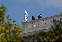 Pictured: Police officers on the roof of one of the building at Herod Atticus Street in Athens, Greece. Tuesday 15 November 2016<br /> Re: US President Barack Obama state visit to Greece