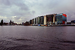 Modern buildings dot the Amsterdam skyline.