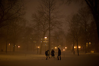 People walk through Harvard Yard in Cambridge, Massachusetts, USA, as Winter Storm Nemo approaches on Friday, Feb. 8, 2013.
