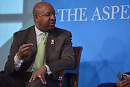 Washington, DC - April 8, 2014: Philadelphia Mayor Michael Nutter (l) participates in a panel discussion at the Aspen Institute's 'Symposium on The State of Race in America.' The symposium was held at the Newseum in the District of Columbia. (Photo by Don Baxter/Media Images International)