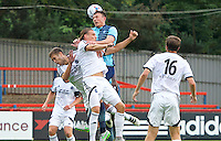 Garry Thompson of Wycombe Wanderers wins the header during the Friendly match between Aldershot Town and Wycombe Wanderers at the EBB Stadium, Aldershot, England on 26 July 2016. Photo by Alan  Stanford.