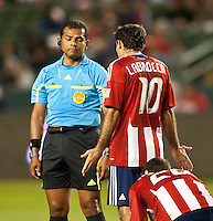 CARSON, CA – APRIL 9, 2011: Chivas USA midfielder Nick LaBrocca (10) pleads his case to referee Yader Reyes during the match between Chivas USA and Columbus Crew at the Home Depot Center, April 9, 2011 in Carson, California. Final score Chivas USA 0, Columbus Crew 0.