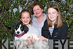 BEST FRIEND: Molly the Spaniel/Terrier cross breed with his best friends at the dog show at the Blennerville Trashing Fair on Sunday l-r: Claire and Iris Conway and Ciara Drinan (Tralee)..