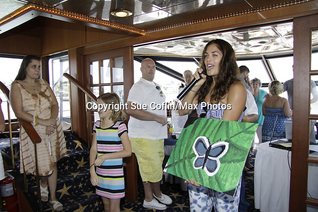 Kelly Thiebaud auctions off her photo and donated time at 15th Southwest Florida Soapfest 2014 Charity Weekend - at Cruisin' and Schmoozin' on May 25, 2104 aboard the Marco Island Princess (boat), Marco Island, Florida.  (Photo by Sue Coflin/Max Photos)
