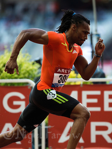 06 JUL 2012 - PARIS, FRA - Marc Macedot powers from the start of the national men's 400m race during the 2012 Meeting Areva athletics meet held in the Stade de France in Paris, France .(PHOTO (C) 2012 NIGEL FARROW)