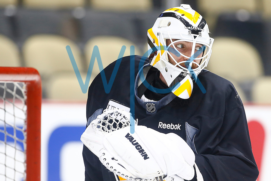 Matt Murray #30 of the Pittsburgh Penguins works out in goal during practice prior to the start of the Stanley Cup Final series between the Pittsburgh Penguins and the San Jose Sharks at Consol Energy Center in Pittsburgh, Pennslyvania on May 29, 2016. (Photo by Jared Wickerham / DKPS)