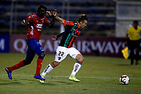 SANTIAGO DE CHILE - CHILE: 06-02-2019: Roberto Gimenez de Club Deportivo Palestino (CHL) disputa el balón con Jesús Murillo de Deportivo Independiente Medellín (COL), durante partido de la Segunda fase, llave 4, entre Club Deportivo Palestino (CHL) y Deportivo Independiente Medellín (COL), por la Copa Conmebol Libertadores 2019 en el estadio San Carlos de Apoquindio, de la ciudad de Santiago de Chile. / Roberto Gimenez of Club Deportivo Palestino (CHL), vies for the ball with Jesus Murillo of Deportivo Independiente Medellin (COL), during a match between Club Deportivo Palestino (CHL) and Deportivo Independiente Medellin of the second phase, key 4, for Copa Conmebol Libertadores 2019 at the San Carlos de Apoquindio Stadium, in the city of Santiago de Chile. Photos: VizzorImage / Andrés Piña / Cont. / Photosport