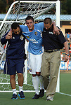 02 June 2012: Puerto Rico's Jamie Cunningham (center) is helped off of the field after suffering a game-ending injury. The Carolina RailHawks defeated the Puerto Rico Islanders 2-1 at WakeMed Soccer Stadium in Cary, NC in a 2012 North American Soccer League (NASL) regular season game.