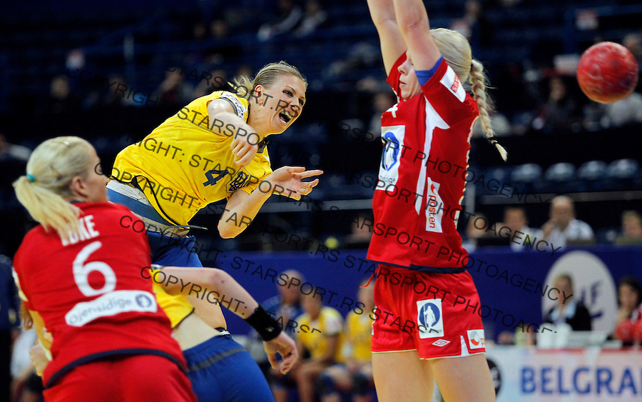BELGRADE, SERBIA - DECEMBER 08: Anastasiia Pidpalova (L) of Ukraine try to score over Ida Bjorndalen (R) of Norway during the Women's European Handball Championship 2012 Group A match between Norway and Ukraine at Arena Hall on December 08, 2012 in Belgrade, Serbia. (Photo by Srdjan Stevanovic/Getty Images)