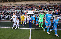 SWANSEA, WALES - FEBRUARY 07: Swansea team led by Ashley Williams (L) and Sunderland exit from the tunnel before the Premier League match between Swansea City and Sunderland AFC at Liberty Stadium on February 7, 2015 in Swansea, Wales.