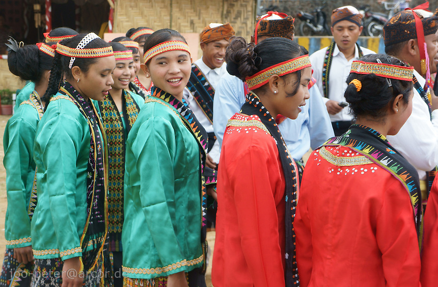 dance performance of girls in traditional costumes in Ruteng, district Manggarai,  island  Flores in archipelago of Indonesia