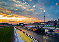 May 4, 2018; Commerce, GA, USA; The sun sets behind the car of NHRA top fuel driver Richie Crampton during qualifying for the Southern Nationals at Atlanta Dragway. Mandatory Credit: Mark J. Rebilas-USA TODAY Sports