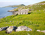 Deserted derelict croft cottage in coastal location on Vatersay Island, Barra, Outer Hebrides, Scotland, UK