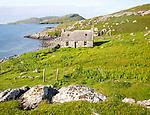 Deserted derelict croft cottage in coastal location on Vatersay Island, Barra, Outer Hebrides, Scotland, UK