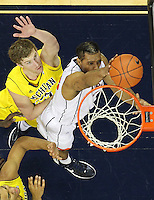 CHARLOTTESVILLE, VA- NOVEMBER 29: Mike Scott #23 of the Virginia Cavaliers shoots over Zack Novak #0 of the Michigan Wolverines during the game on November 29, 2011 at the John Paul Jones Arena in Charlottesville, Virginia. Virginia defeated Michigan 70-58. (Photo by Andrew Shurtleff/Getty Images) *** Local Caption *** Mike Scott;Zack Novak